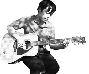 殷俊在弹吉他