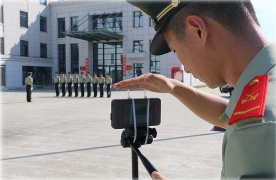 """各参赛队伍通过视频连线进行""""网络云会操""""。 温州武警供图"""