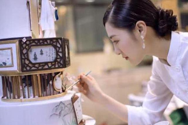 姑娘将西湖搬上蛋糕 让世界感受杭州之美(图)