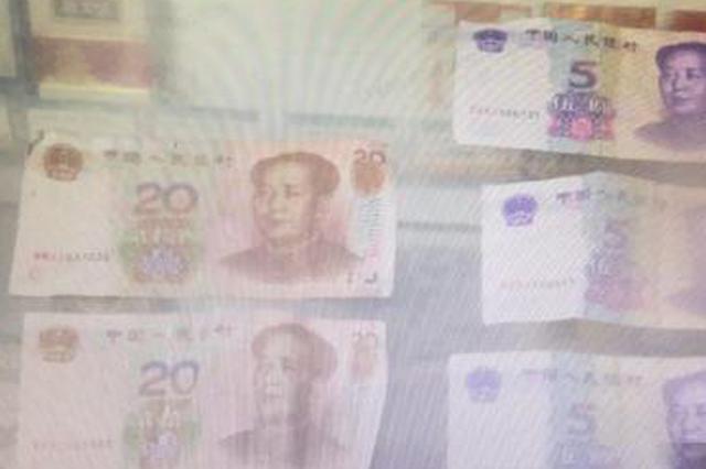 没钱花就自己印 男子印3000余元假币在金华被抓(图)