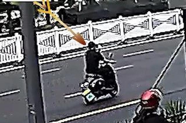 金华一男子偷车后还向车主招手 在高铁站被民警抓获