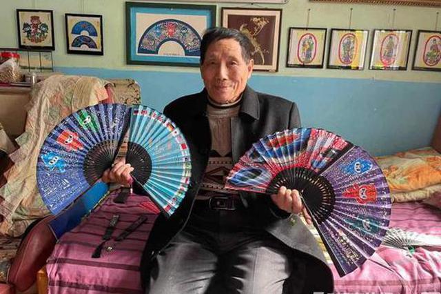 杭州90岁剪纸王完成新作 做了800把亚运扇(组图)