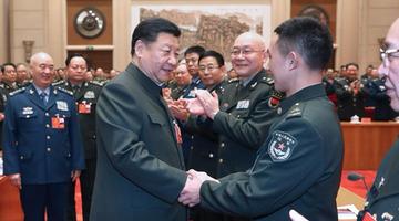习近平出席解放军和武警部队代表团会议
