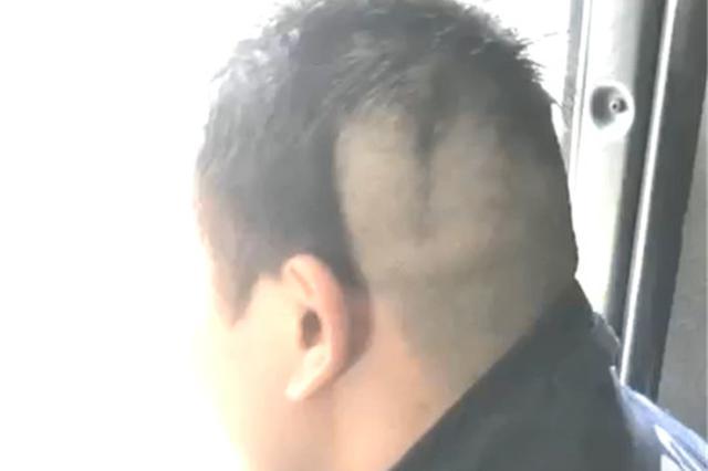湖州消防员头发剃到一半去灭火 照片走红朋友圈(图)