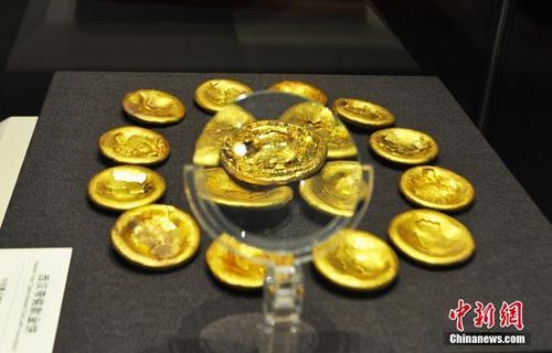 圖為西漢海昏侯劉賀墓出土的金餅。劉占昆 攝