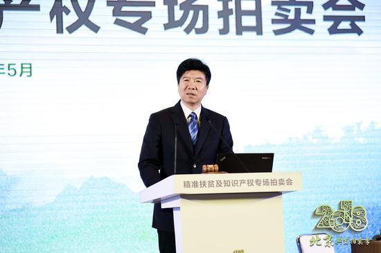 北京市商务委员会主任闫立刚