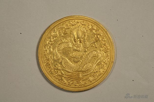 234b丙午大清金幣一兩,重量37、2克,直徑38、8毫。光邊。