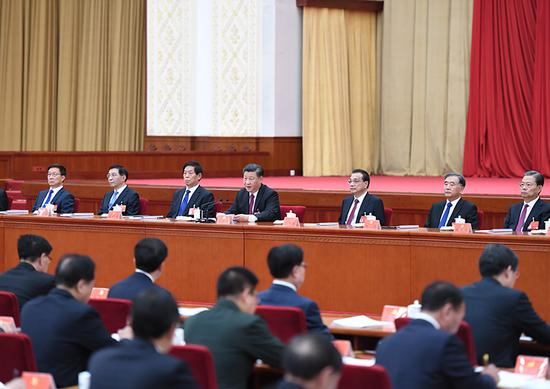 中国共产党第十九届中央委员会第四次全体会议,于2019年10月28日至31日在北京举行。这是习近平、李克强、栗战书、汪洋、王沪宁、赵乐际、韩正等在主席台上。新华社记者 张领 摄