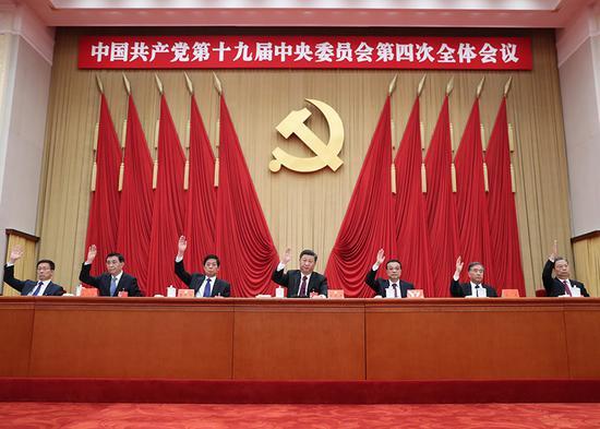 中国共产党第十九届中央委员会第四次全体会议,于2019年10月28日至31日在北京举行。这是习近平、李克强、栗战书、汪洋、王沪宁、赵乐际、韩正等在主席台上。新华社记者 鞠鹏 摄