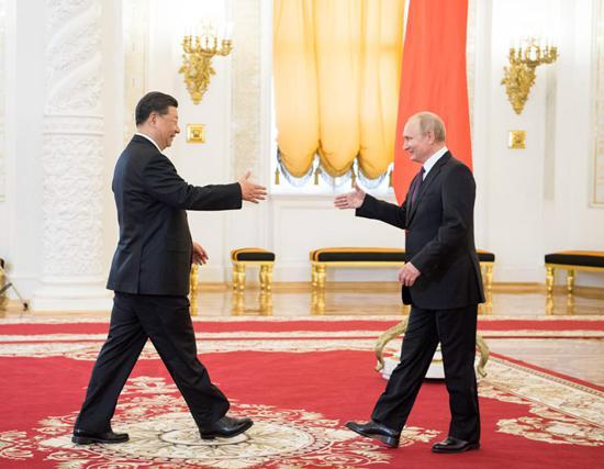 我国主席习近平推动中俄关系走进新时代 好邻居真同伴