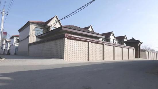 黄继宗一家居住的联排别墅外景(资料图片)