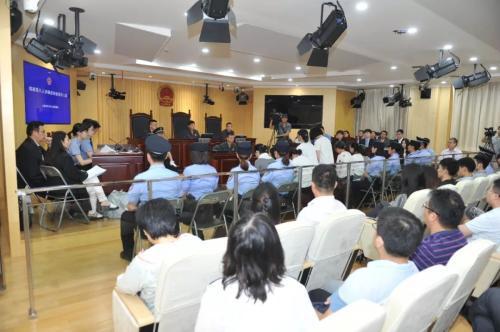 图为庭审现场。(金文斌 摄) 图片来源:上海长宁法院官方微信。