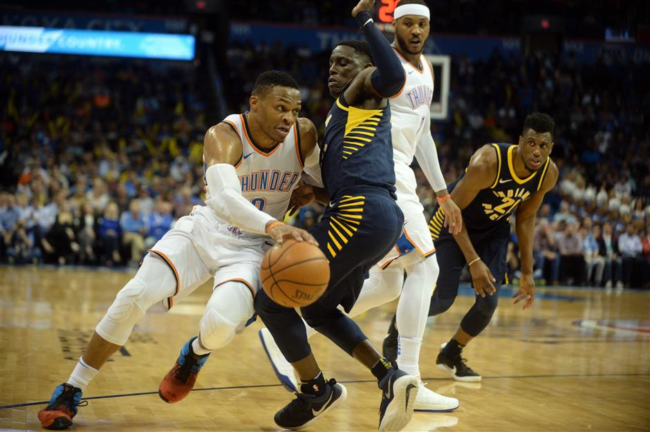 c0cb986e82d Oklahoma City Thunder guard Russell Westbrook drives to the basket against  Indiana Pacers guard Darren Collison