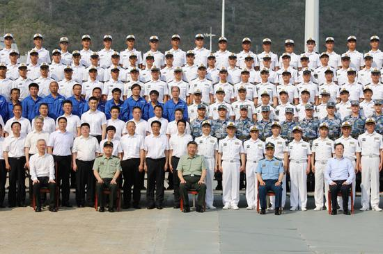 Chinese President Xi Jinping, also general secretary of the Communist Party of China Central Committee and chairman of the Central Military Commission, meets with representatives of vessel researchers and naval officers and soldiers in Sanya, south China's Hainan Province, April 23, 2021. Xi attended the commissioning ceremony of three naval vessels, the Changzheng-18, the Dalian, and the Hainan, and boarded the vessels after the ceremony. The vessels were delivered to the People's Liberation Army (PLA) Navy and placed in active service on Friday at a naval port in Sanya, south China's Hainan Province. (Xinhua/Li Gang)