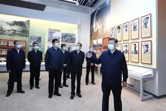 Xi Jinping and other Communist Party of China and state leaders Li Keqiang, Li Zhanshu, Wang Yang, Wang Huning, Zhao Leji, Han Zheng and Wang Qishan visit an exhibition commemorating the 70th anniversary of the Chinese People's Volunteers (CPV) army entering the Democratic People's Republic of Korea (DPRK) in the War to Resist U.S. Aggression and Aid Korea at the Military Museum of the Chinese People's Revolution in Beijing, capital of China, Oct. 19, 2020. (Xinhua/Ju Peng)