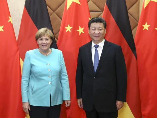Chinese President Xi Jinping (R) meets with German Chancellor Angela Merkel in Beijing, capital of China, June 13, 2016. (Xinhua/Pang Xinglei)