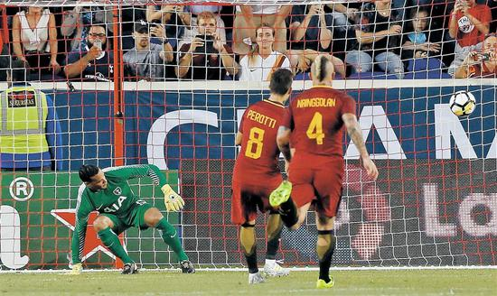 AS Roma's Diego Perotti scores his team's first goal past Tottenham Hotspur goalkeeper Michel Vorm during their International Champions Cup match at the Red Bull Arena in New Jersey on Tuesday. Roma secured a 3-2 victory. — Reuters