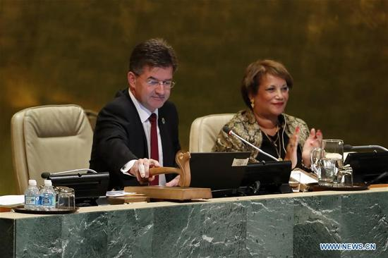 Miroslav Lajcak (L), President of the 72nd United Nations General Assembly, gavels to close the General Debate of the 72nd United Nations General Assembly at the UN headquarters in New York, Sept. 25, 2017. The VIP session of the United Nations General Assembly (UNGA) for 2017 concluded here on Monday, after all 196 representatives spoke at the marble podium in the past week. (Xinhua/Li Muzi)