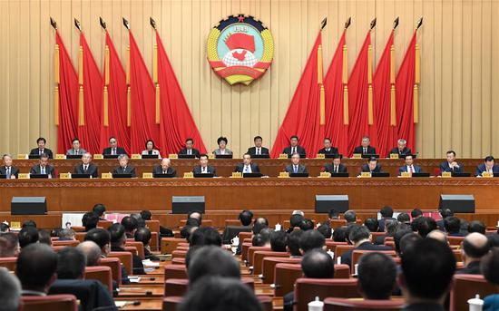 The Standing Committee of the 13th National Committee of the Chinese People's Political Consultative Conference (CPPCC) holds its 14th session, which focuses on studying and following the spirit of the fifth plenary session of the 19th Communist Party of China (CPC) Central Committee, in Beijing, capital of China, Nov. 9, 2020. Chinese Premier Li Keqiang, a member of the Standing Committee of the Political Bureau of the CPC Central Committee, made a report by invitation at the session. Wang Yang, also a member of the Standing Committee of the Political Bureau of the CPC Central Committee and chairman of the CPPCC National Committee, presided over the opening of the session. (Xinhua/Rao Aimin)