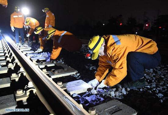 Workers Prepare To Adjust The Direction Of A Railway At Night In Nanning Capital