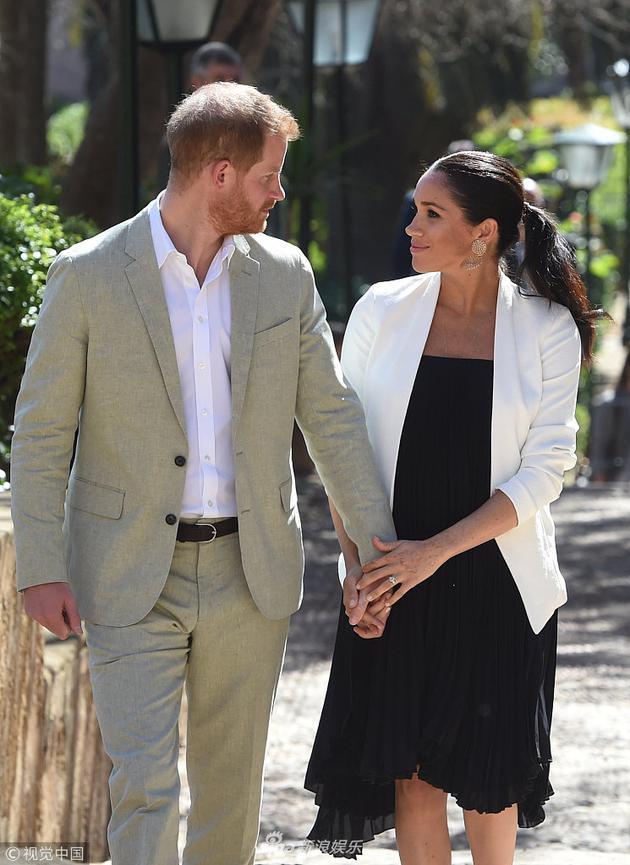 哈里王子与王妃。