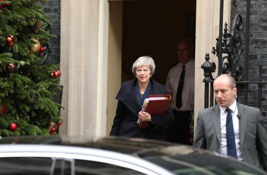 12月12日,在英国伦敦,英国始相特雷莎·梅离下手相府准备进走始相问应。新华社发(伊莎贝尔·因方特斯摄)