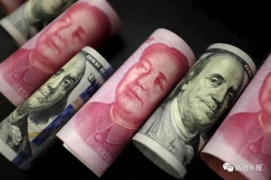 去年第四季美元在全球外储占比降至25年最低 人民币占比连升四季