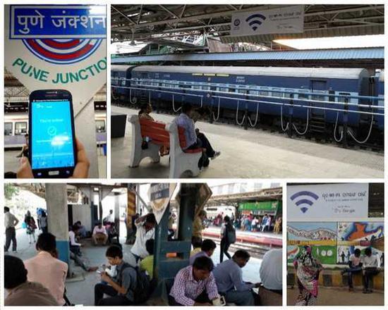 图:印度旅客在火车站使用谷歌免费WiFi服务