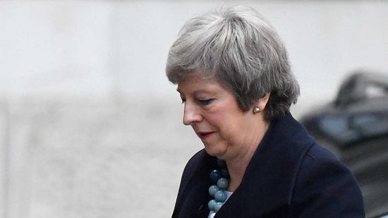 """英国议会下院14日投票通过一项要求推迟""""脱欧""""的政府动议"""