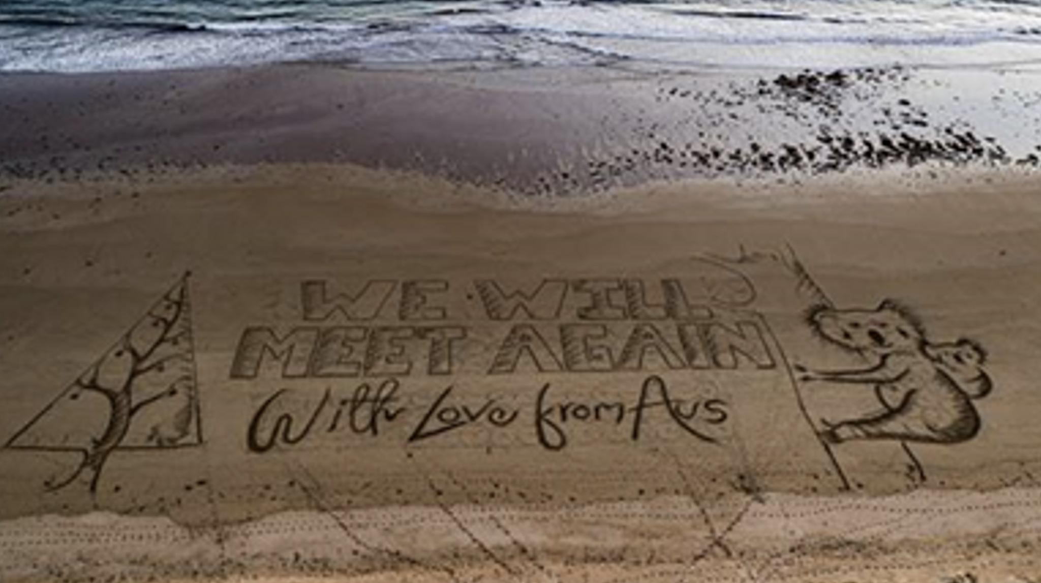"""澳大利亚沙滩现致英国人的巨型圣诞贺卡:""""我们将再会"""""""