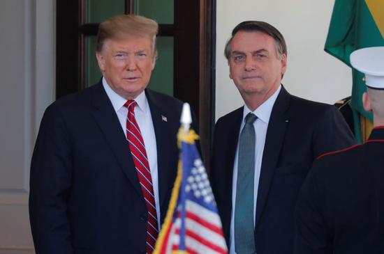 2019年3月19日,美国华盛顿,美国总统特朗普在白宫欢迎巴西总统博尔索纳罗。REUTERS/Carlos Barria