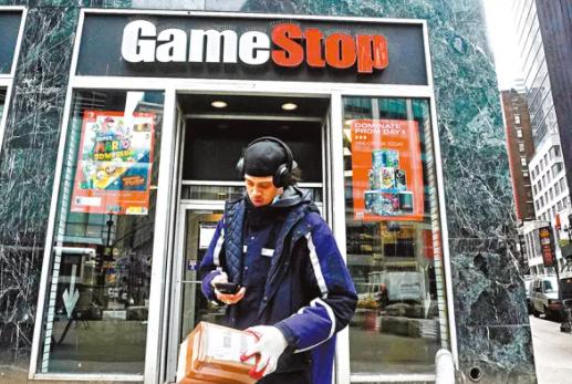 """专卖二手电玩游戏店GameStop近日引发了散户吊打华尔街对冲基金的""""战争"""",4个交易日狂飙逾700%,令沽空该股的大鳄损兵折将。(路透社)"""