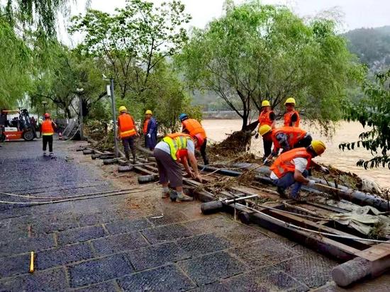 洪水危及龙门石窟 龙江建设者48小时奋战紧急抢险