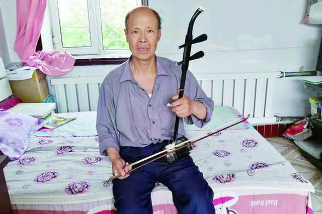 做二胡小提琴创编乐曲 七旬老翁谭志:音乐相伴乐享晚年
