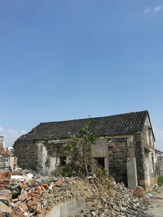 """""""仁丹""""二字所在的旧宅。王世清供图"""
