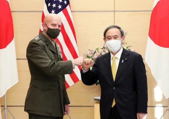 日本首相会晤美陆战队司令:保持强大军力遏制中国
