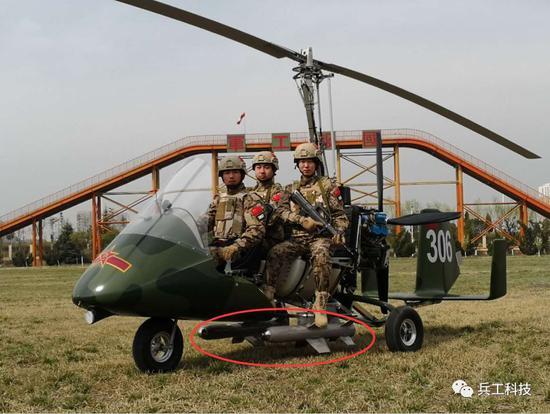 """图注:""""猎鹰""""抨击型旋翼机能够挂载激光制导导弹,图中红圈内为导弹特写"""