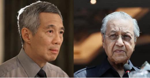 原料图:新添坡总理李显龙(左)与马来西亚总理马哈蒂尔
