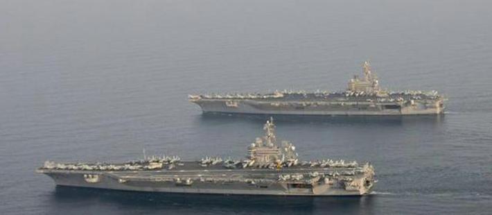 美军兵分两路:一边派航母突入波斯湾 一边空袭伊朗盟友