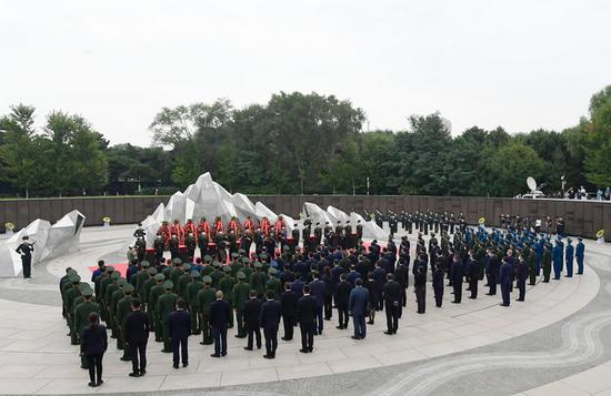 9月3日 第八批在韩中国人民志愿军烈士遗骸安葬仪式在沈阳举行 新华社记者 杨青 摄