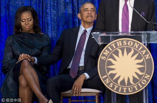 奥巴马与其夫人米歇尔(视觉中国)