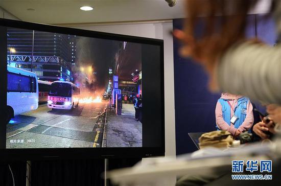 12月27日,警方在讯息发布会上展现照片。 新华社记者 李钢 摄