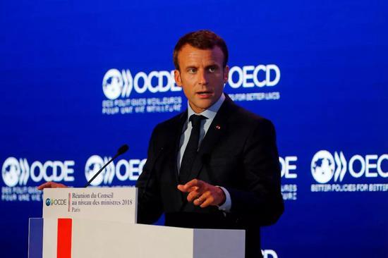 法国总统马克龙在经济合作与发展组织会议上讲话。新华社/法新