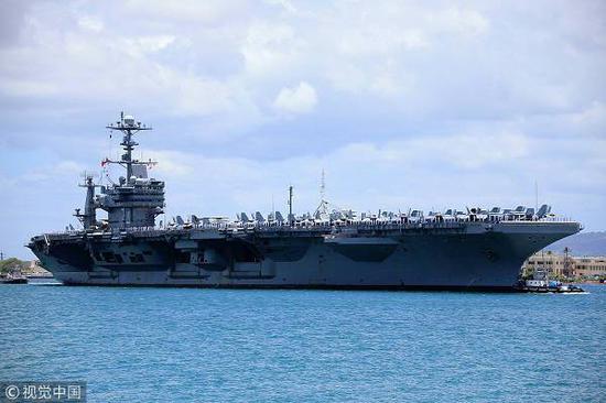 """21日,美国""""斯坦尼斯""""号航母战斗群驶入波斯湾。(图:视觉中国)"""