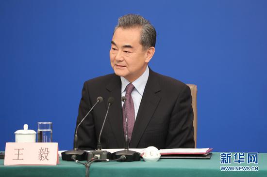3月8日,国务委员兼外交部长王毅回答中外记者提问。(图源:新华网)