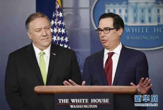 1月10日,美国财政部长姆努钦(右)在华盛顿白宫举行的记者会上发言 (图片来源:新华社记者 刘杰 摄)