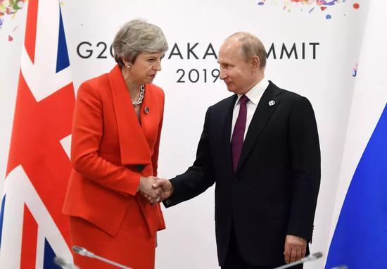 6月28日,俄罗斯总统普京与英国首相特雷莎·梅举行会晤。