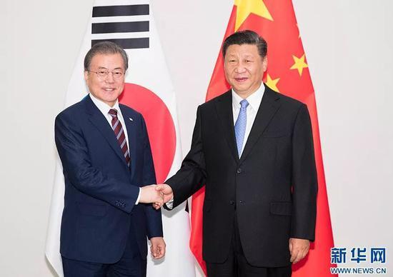 (图:6月27日,国家主席习近平在日本大阪会见韩国总统文在寅。)