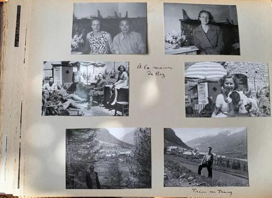 埃莱娜·郎之万-约里奥向记者展示珍藏的家庭相册,里面有钱三强和其父母及全家的合影。新华社记者高静摄