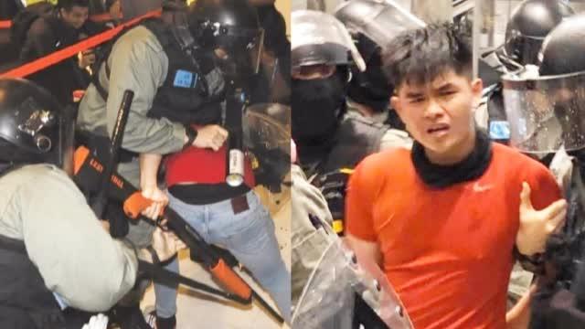 红衣暴徒袭警夺枪 手扣扳机时被港警用防爆盾擒身